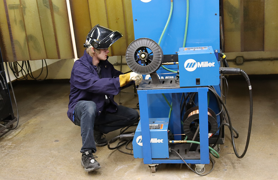 Adam Nelson, a senior at Wausau West, adjusts a welding machine during the Regional SkillsUSA competition.
