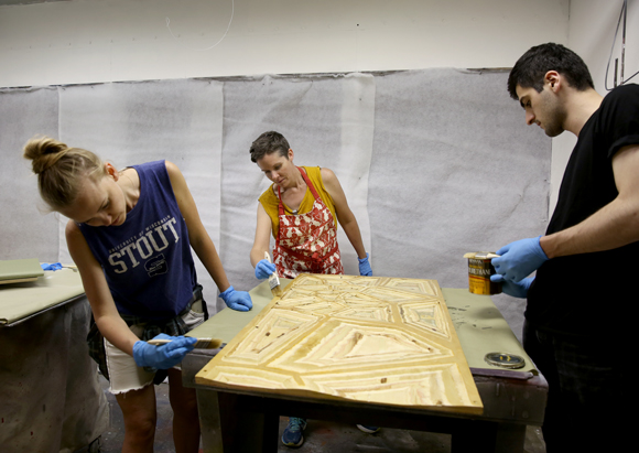 UW-Stout's Jennifer Astwood, center, and Russian designers Yaroslava Barmenkova, left, and Azamat Tavitov work on sensory safety devices during a two-week program at UW-Stout.