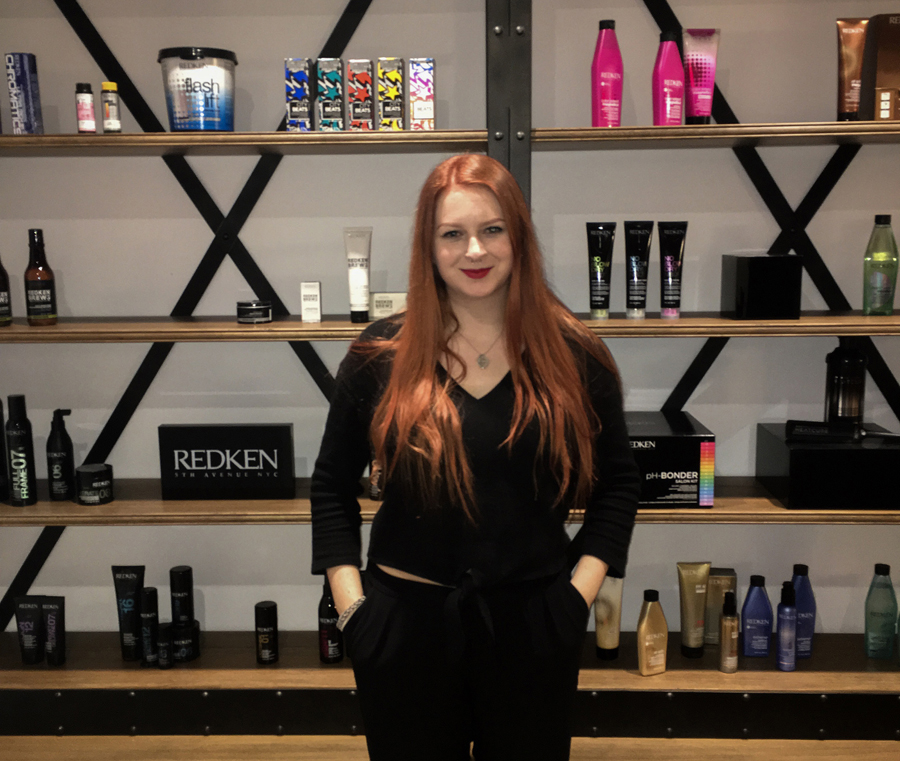 Anna Haggerty next to Redken products at L'Oreal.
