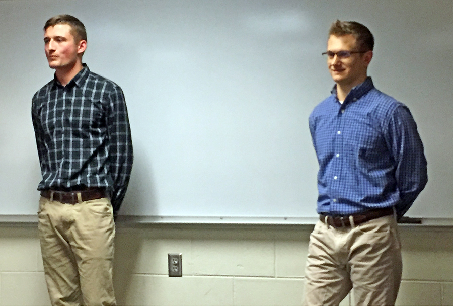 UW-Stout students Brad Osatiuk, at left, and Cam Ambrust talk about the custom controls and processing business they plan to start after they graduate in December.