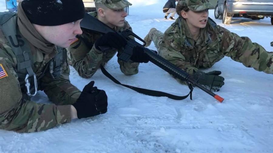 ROTC students prone in the snow.