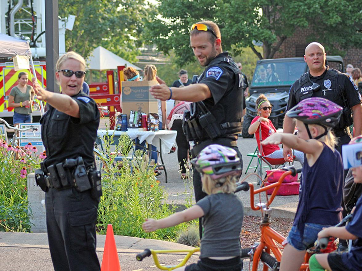 Healthier officers help keep the community safe. Menomonie police officers taught bicycle safety at a National Night Out event.