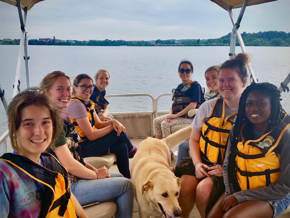 LAKES REU students on a pontoon ride of Lake Menomin.
