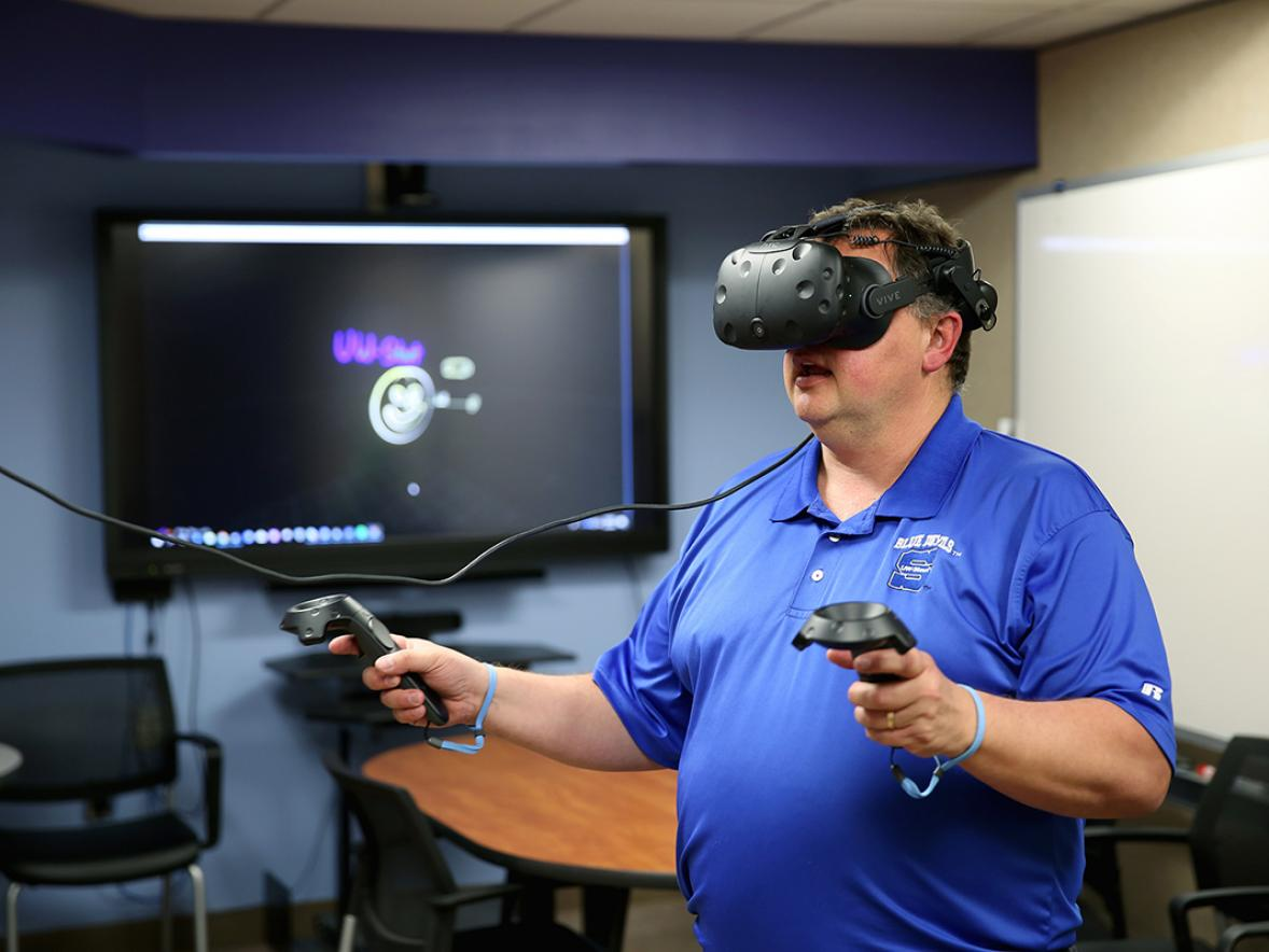 Kevin W. Tharp using virtual reality technology.