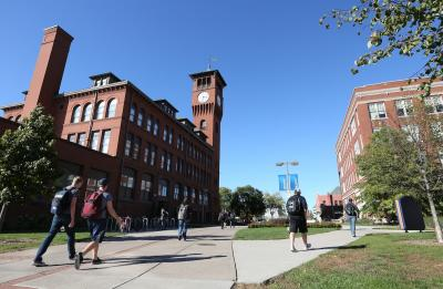 Students walk to classes on campus, near Bowman Hall and Harvey Hall.