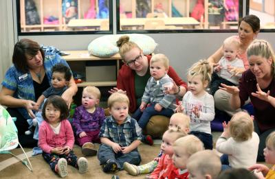 Chancellor Bob Meyer reads to children at the Child and Family Study Center's Infant/Toddler Lab in Heritage Hall Wednesday, November 15, 2017. (UW-Stout photo by Brett T. Roseman)