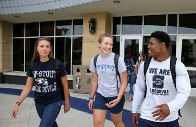 UW-Stout students are pictured interacting on campus together Tuesday, August 8, 2017. Pictured from left are Elly Friberg, Jenna Welke and Keyshawn Carpenter. (UW-Stout Photo by Brett T. Roseman)